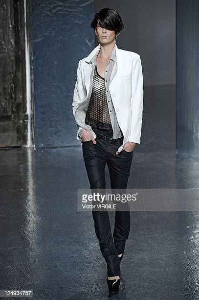 Model walks the runway at the Theyskens' Theory Spring 2012 fashion show during Mercedes-Benz Fashion Week at Center 548 on September 13, 2011 in New...