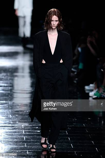 Model walks the runway at the Theyskens' Theory Spring 2013 show during Mercedes-Benz Fashion Week at Skylight at Moynihan Station on September 10,...