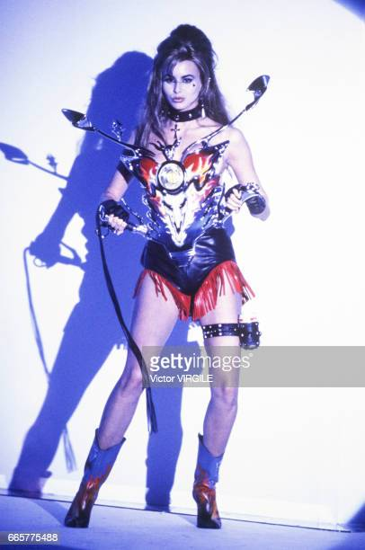 Model walks the runway at the Thierry Mugler Ready to Wear Spring/Summer 1992 fashion show during the Paris Fashion Week in October, 1991 in Paris,...