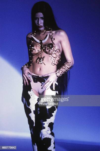 A model walks the runway at the Thierry Mugler Ready to Wear Spring/Summer 1992 fashion show during the Paris Fashion Week in October 1991 in Paris...
