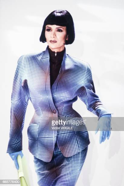 Model walks the runway at the Thierry Mugler Ready to Wear Fall/Winter 1989-1990 fashion show during the Paris Fashion Week in March, 1989 in Paris,...