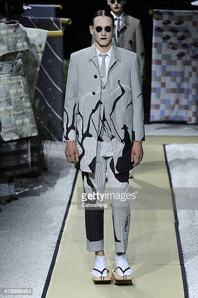 A model walks the runway at the Thom Browne Spring Summer 2016 fashion show during Paris Menswear Fashion Week on June 28 2015 in Paris France