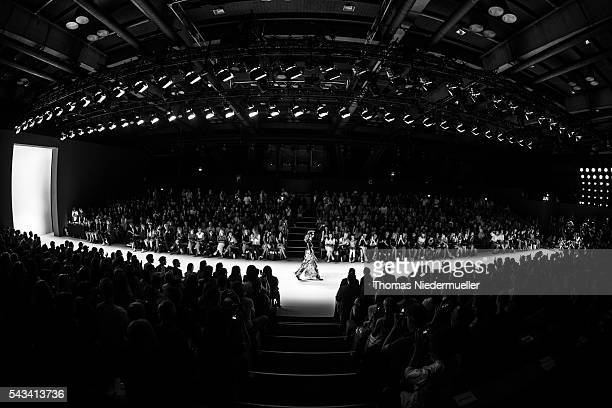 A model walks the runway at the Thomas Hanisch show during the MercedesBenz Fashion Week Berlin Spring/Summer 2017 at Erika Hess Eisstadion on June...