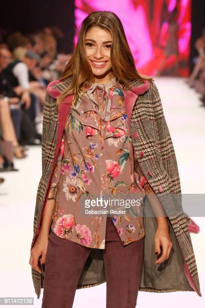 Model walks the runway at the Thomas Rath show during Platform Fashion January 2018 at Areal Boehler on January 28, 2018 in Duesseldorf, Germany.