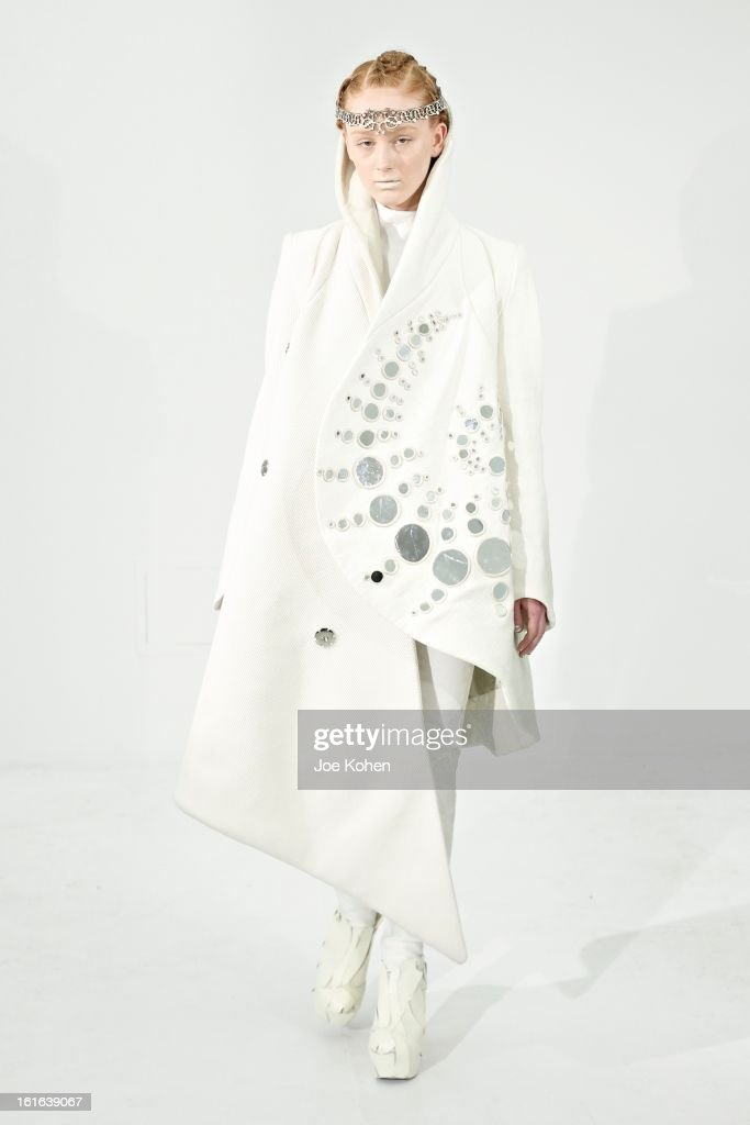A model walks the runway at the threeASFOUR fall 2013 fashion show during Mercedes-Benz Fashion Week at The Hole Gallery on February 13, 2013 in New York City.