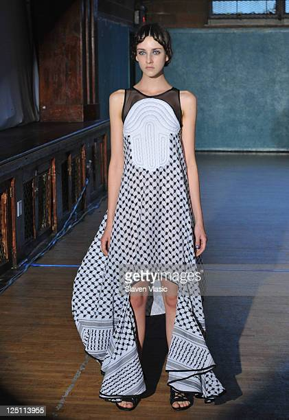 A model walks the runway at the threeASFOUR Spring 2012 fashion show during MercedesBenz Fashion Week at St Patrick's Old Cathedral Youth Center on...