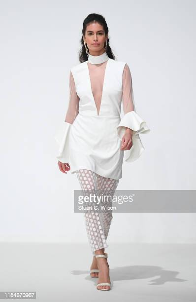A model walks the runway at the Thym show during the FFWD October Edition 2019 at the Dubai Design District on October 31 2019 in Dubai United Arab...
