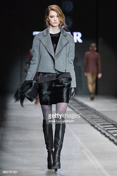 A model walks the runway at the Tiger of Sweden show during MercedesBenz Stockholm Fashion Week AW14 on January 29 2014 in Stockholm Sweden