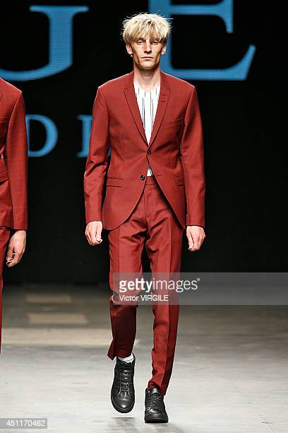Model walks the runway at the Tiger of Sweden show during the London Collections: Men SS15 on June 17, 2014 in London, England.