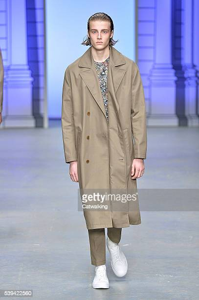 Model walks the runway at the Tiger of Sweden Spring Summer 2017 fashion show during London Menswear Fashion Week on June 11, 2016 in London, United...