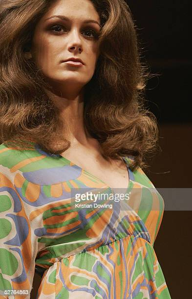 Model walks the runway at the Tim O Connor Collection presentation at Billich Gallery in the Overseas Passenger Terminal during the Mercedes...