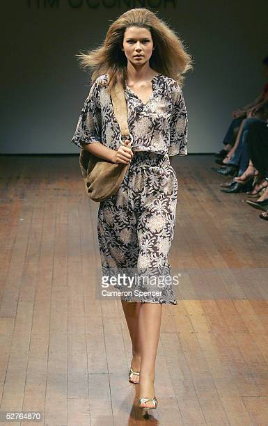 Model walks the runway at the Tim O'Connor collection presentation at the Billich Gallery during the Mercedes Australian Fashion Week May 6, 2005 in...