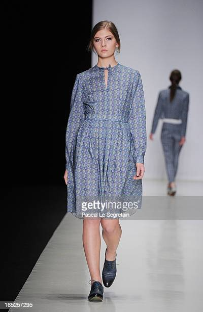 A model walks the runway at the Timur Kim show during MercedesBenz Fashion Week Russia Fall/Winter 2013/2014 at Manege on April 2 2013 in Moscow...