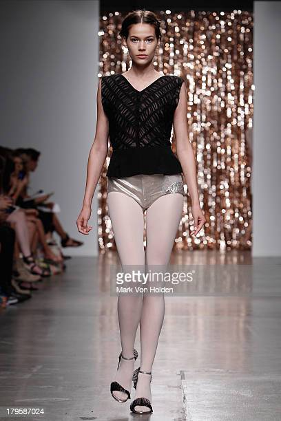 A model walks the runway at the Tocca fashion show during MercedesBenz Fashion Week at Pier 59 on September 5 2013 in New York City