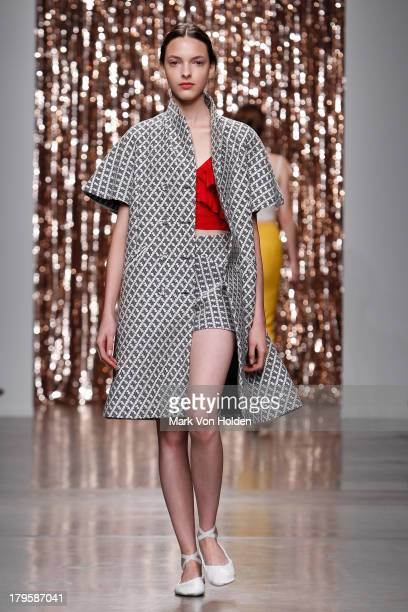 Model walks the runway at the Tocca fashion show during Mercedes-Benz Fashion Week at Pier 59 on September 5, 2013 in New York City.