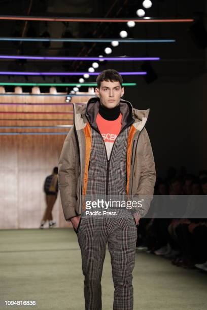 A model walks the runway at the Todd Snyder Fall/Winter 2019 Collection during New York Fashion Week Men's at Pier 59 Studios Manhattan