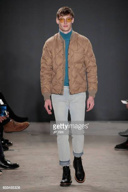 A model walks the runway at the Todd Snyder fashion show during NYFW Men's at Skylight Clarkson North on February 1 2017 in New York City