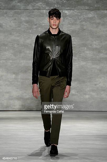 Model walks the runway at the Todd Snyder fashion show during Mercedes-Benz Fashion Week Spring 2015 at The Pavilion at Lincoln Center on September...