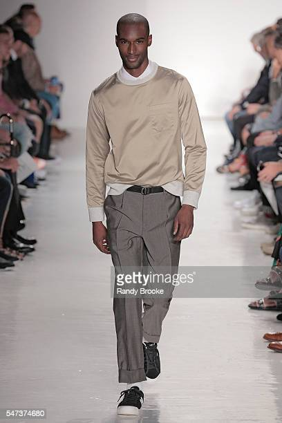 A model walks the runway at the Todd Snyder Runway show during New York Fashion Week Men's S/S 2017 at Skylight Clarkson Sq on July 14 2016 in New...