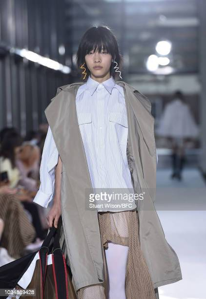 A model walks the runway at the TOGA show during London Fashion Week September 2018 at the Queen Elizabeth || Centre on September 17 2018 in London...