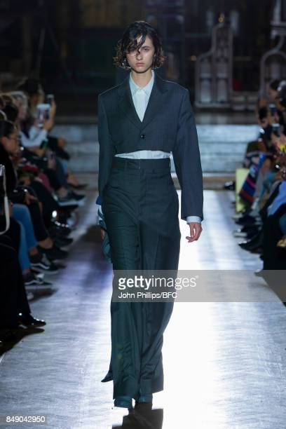 Model walks the runway at the TOGA show during London Fashion Week September 2017 on September 18, 2017 in London, England.