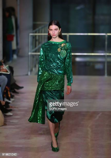 A model walks the runway at the TOGA show during London Fashion Week February 2018 at BFC Show Space