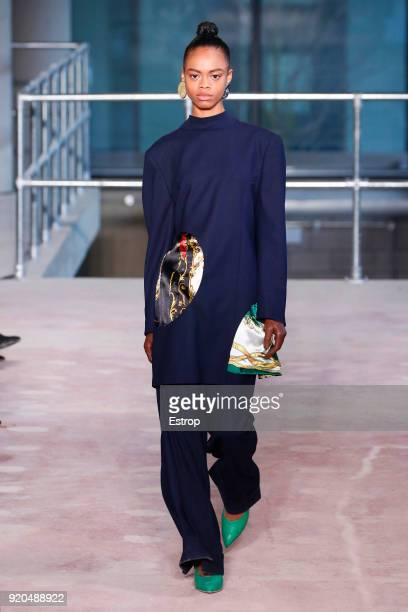 A model walks the runway at the Toga show during London Fashion Week February 2018 on February 17 2018 in London England