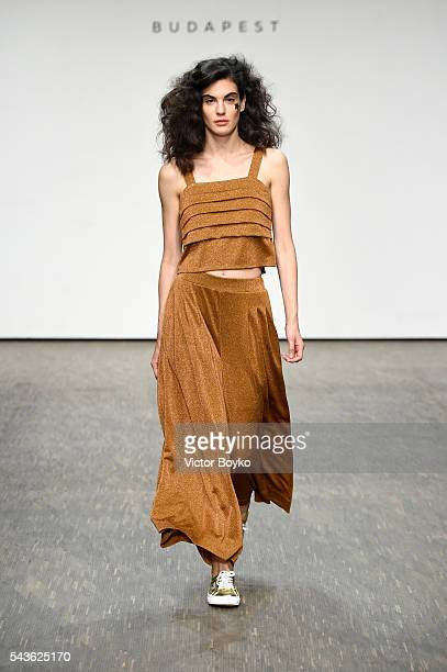 A model walks the runway at the Tomcsanyi show during the MercedesBenz Fashion Week Berlin Spring/Summer 2017 at Stage at me Collectors Room on June...