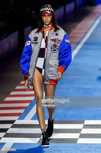 Model walks the runway at the TOMMYNOW by Tommy Hilfiger Spring Summer 2018 fashion show during Milan Fashion Week on February 25, 2018 in Milan,...