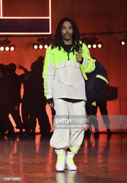 A model walks the runway at the TommyNow show during London Fashion Week February 2020 at the Tate Modern on February 16 2020 in London England