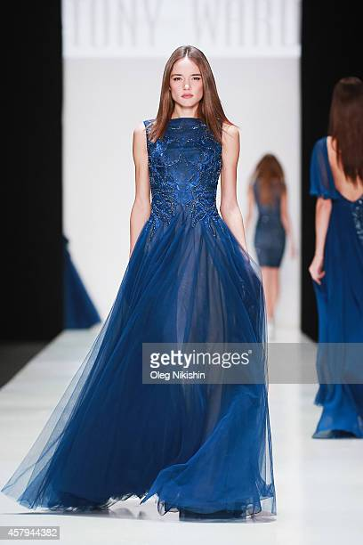 A model walks the runway at the Tony Ward on Day 4 of MercedesBenz Fashion Week Russia S/S 2015 on October 25 2014 in Moscow Russia