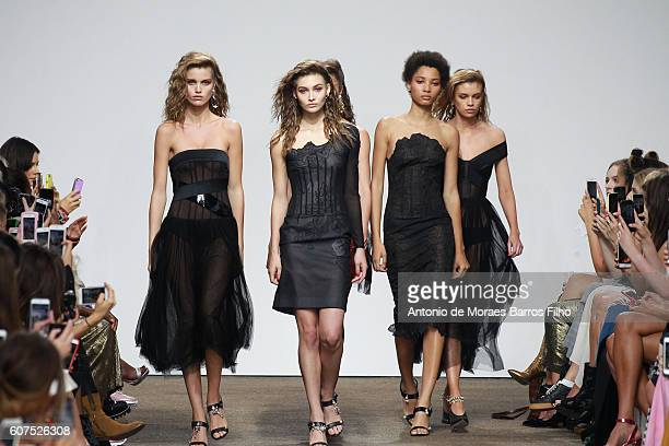 Model walks the runway at the Top Shop Unique show during London Fashion Week Spring/Summer collections 2016/2017 on September 18, 2016 in London,...