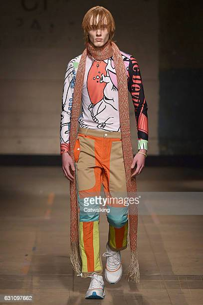 A model walks the runway at the Topman Design Autumn Winter 2017 fashion show during London Menswear Fashion Week on January 6 2017 in London United...