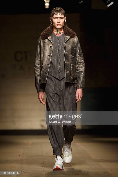 A model walks the runway at the TOPMAN DESIGN show during London Fashion Week Men's January 2017 collections at Topman Show Space on January 6 2017...
