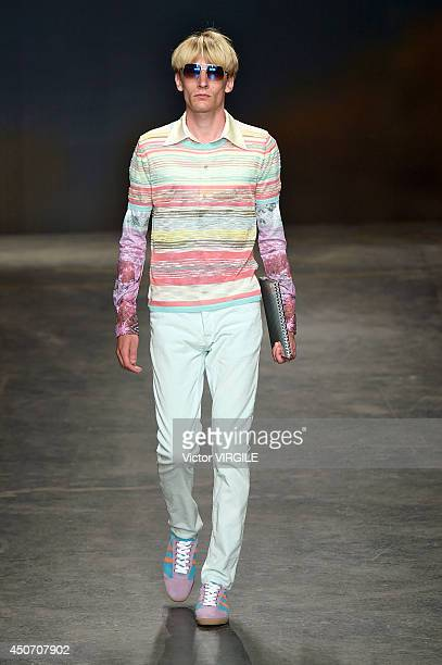 A model walks the runway at the TOPMAN Design show during the London Collections Men SS15 on June 15 2014 in London England