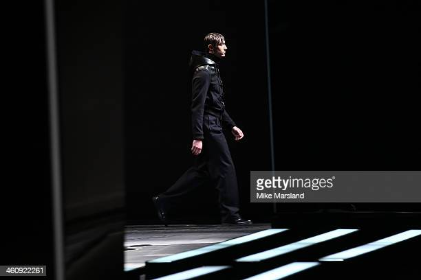 A model walks the runway at the Topman Design show during The London Collections Men Autumn/Winter 2014 on January 6 2014 in London England