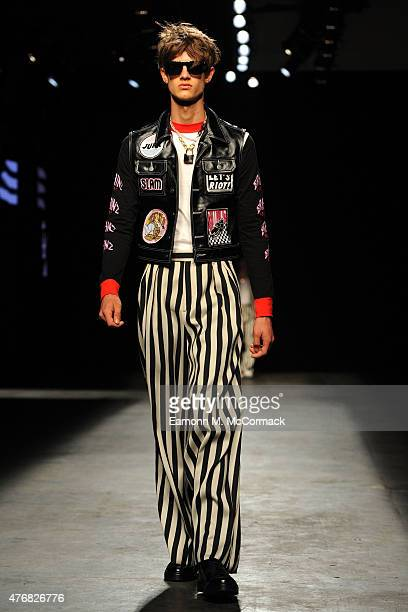 A model walks the runway at the Topman Design show during The London Collections Men SS16 at The Old Sorting Office on June 12 2015 in London England
