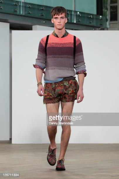 A model walks the runway at the TOPMAN Design S/S 2012 show at London Fashion Week at The Royal Opera House on September 21 2011 in London England