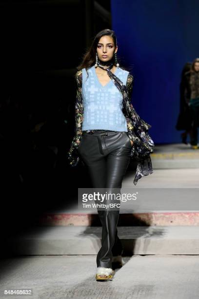 A model walks the runway at the TOPSHOP show during London Fashion Week September 2017 on September 17 2017 in London England