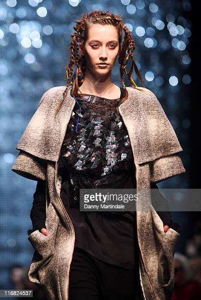 A model walks the runway at the Topshop Unique show during London Fashion Week Autumn/Winter 2009 at at University of Westminster on February 21 2009...
