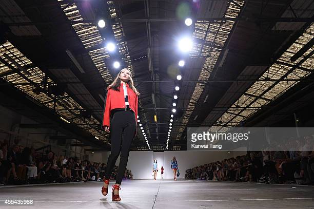 Model walks the runway at the TopShop Unique show during London Fashion Week Spring Summer 2015 at TopShop Show Space on September 14 2014 in London...