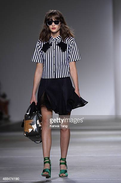 A model walks the runway at the TopShop Unique show during London Fashion Week Spring Summer 2015 at TopShop Show Space on September 14 2014 in...