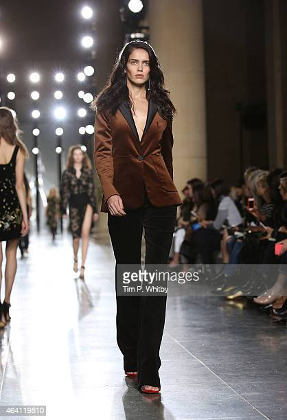 A model walks the runway at the TOPSHOP Unique show during London Fashion Week Fall/Winter 2015/16 at Tate Britain on February 22 2015 in London...