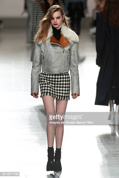A model walks the runway at the Topshop Unique show during London Fashion Week Autumn/Winter 2016/17 at Topshop Space on February 21 2016 in London...