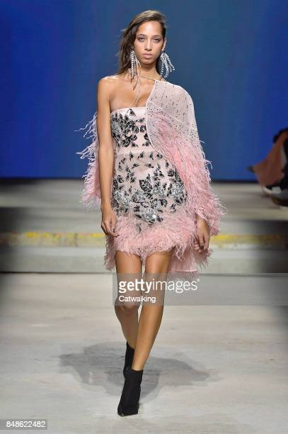 A model walks the runway at the Topshop Unique Spring Summer 2018 fashion show during London Fashion Week on September 17 2017 in London United...