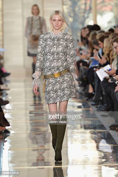 A model walks the runway at the Tory Burch fashion show during MercedesBenz Fashion Week Fall 2014 at Avery Fisher Hall at Lincoln Center for the...