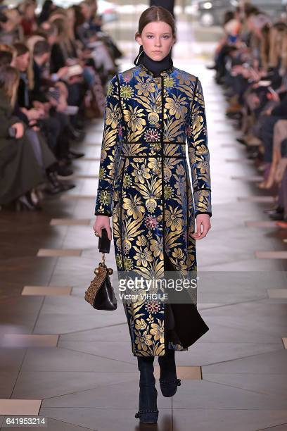 9e7ac95f98ee A model walks the runway at the Tory Burch Ready to Wear Fall Winter  20172018 fashion