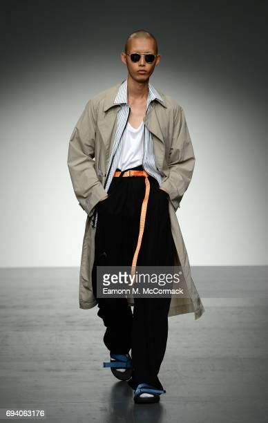 A model walks the runway at the Tourne de Transmission show during the London Fashion Week Men's June 2017 collections on June 9 2017 in London...