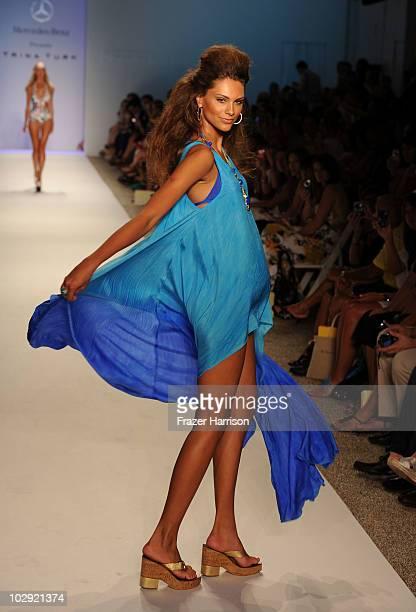 Model walks the runway at the Trina Turk 2011 fashion show during MercedesBenz Fashion Week Swim at The Raleigh on July 15 2010 in Miami Beach Florida