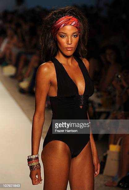 A model walks the runway at the Trina Turk 2011 fashion show during MercedesBenz Fashion Week Swim at the Raleigh on July 15 2010 in Miami Beach...